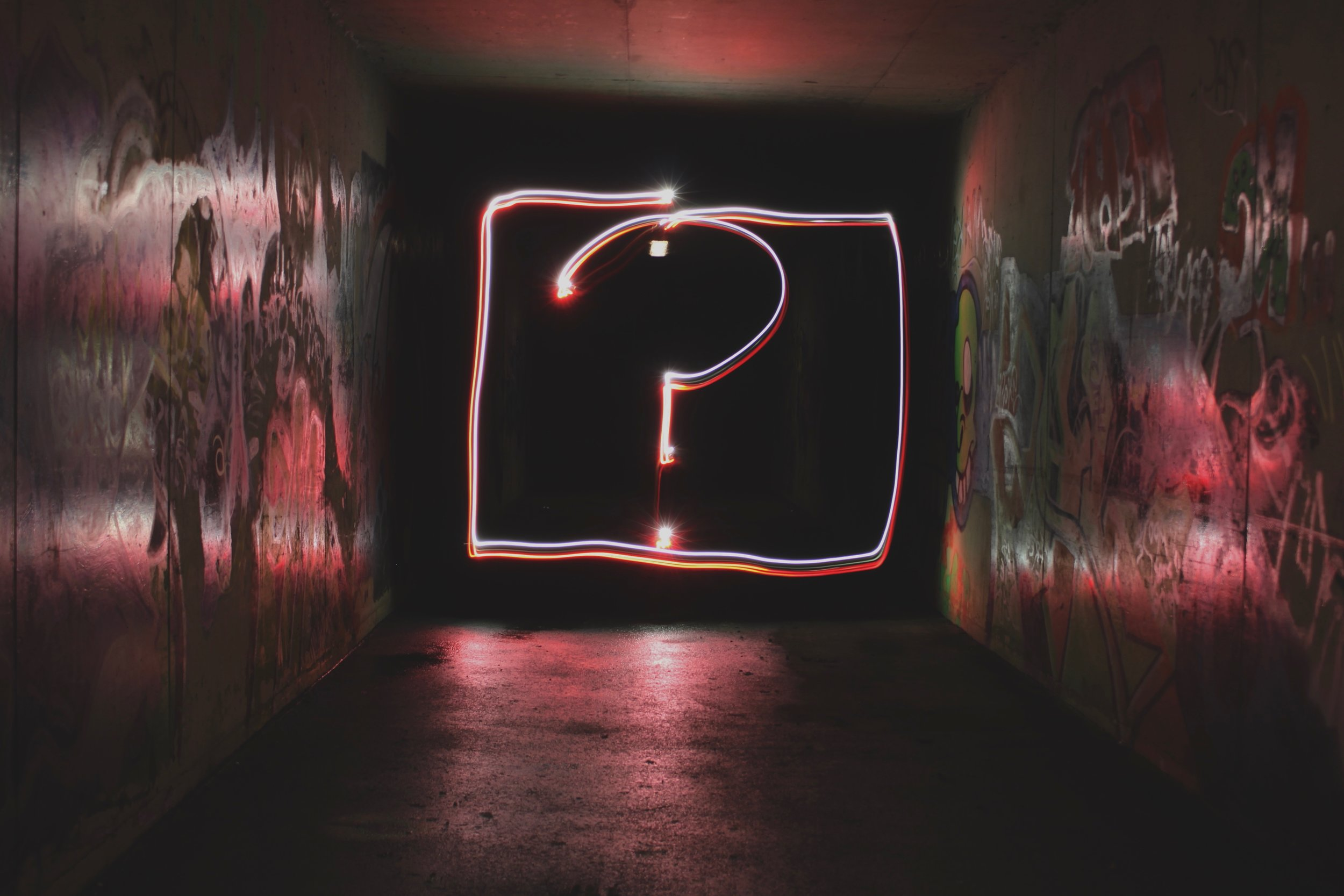 question mark in a dark room asking questions in a pandemic