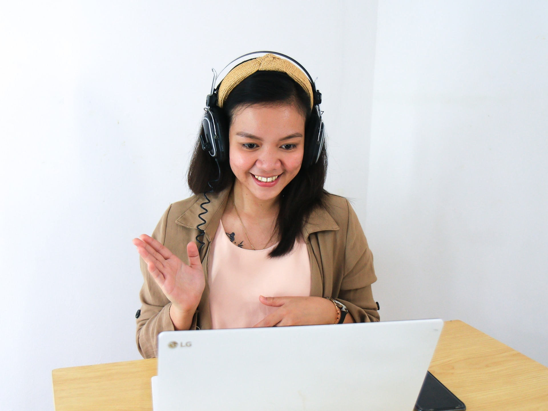 woman conducting survey using live televideo interviews