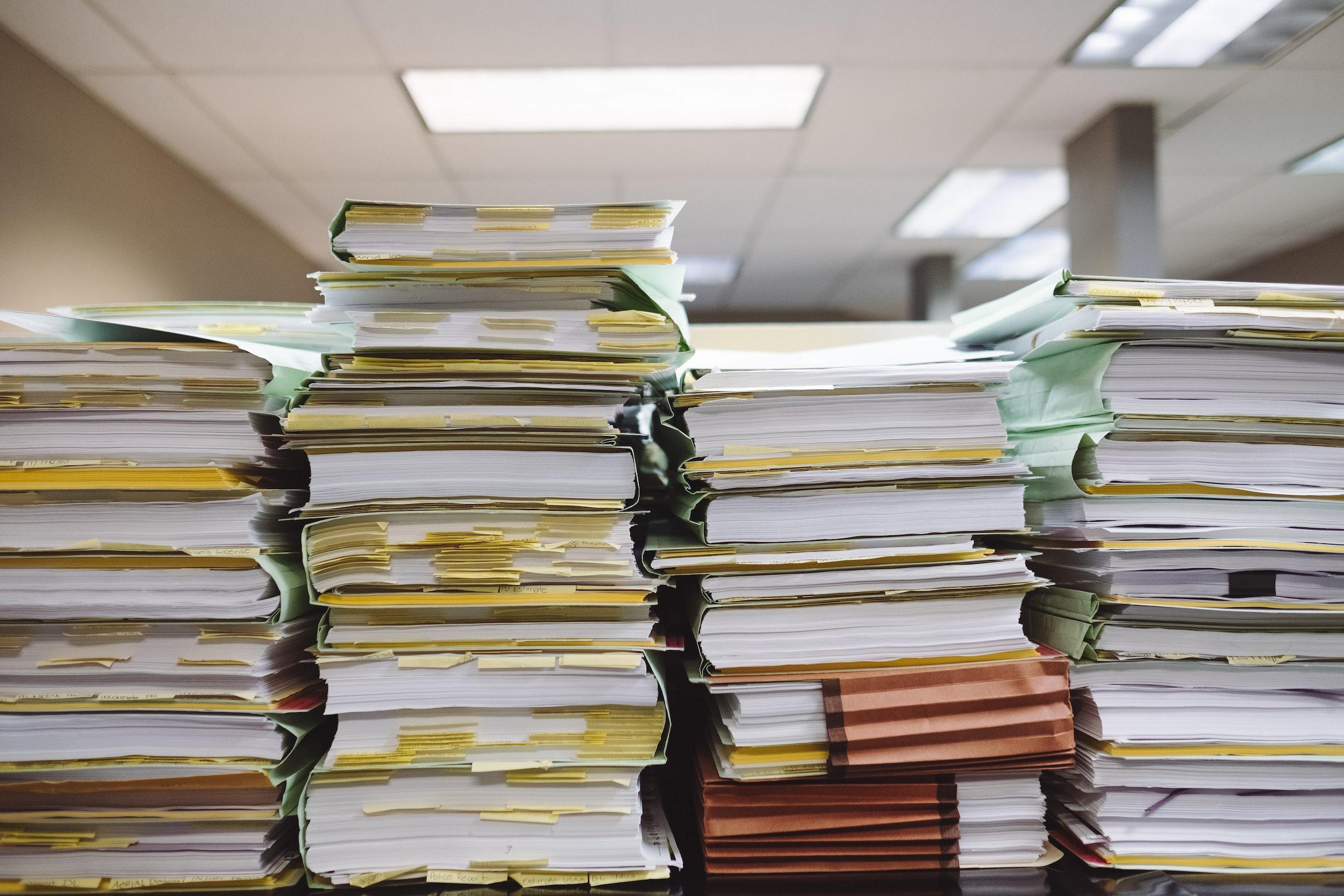 piles of regulatory paperwork FDA 510 k stacks of papers